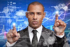 Double exposure of serious businessman with dark skin wears formal suit, points at abstract digital business interface, on graphics and charts, analyzes current market conditions. Visual effects