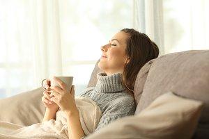 Woman relaxing holding a mug