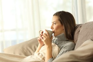 Woman relaxing drinking coffee