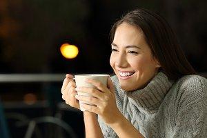 Happy girl drinking coffe