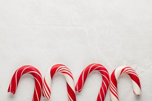 Christmas decors with gray background. Candy cane. Top view with copy space
