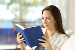 Reader reading a paper book