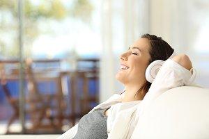 happy girl relaxing listening music
