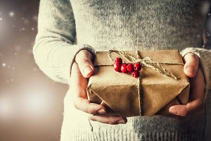 Girl holds a gift for a new year