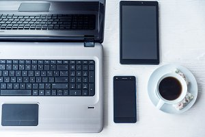Laptop with tablet and smartphone