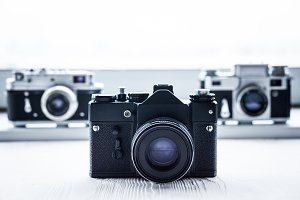 retro cameras on white background