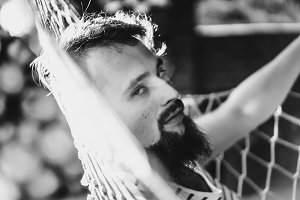 bearded man in a hammock