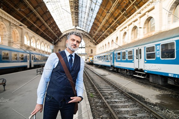 Mature Businessman On A Train Station