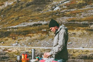 Man cooking outdoor in mountains