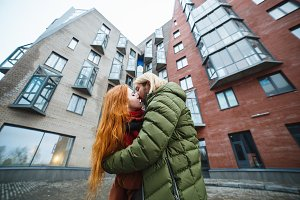Couple kissing outdoors in a urban surroundings.