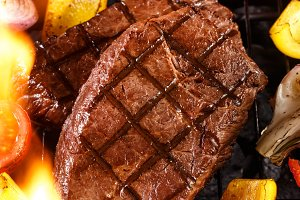 Beef steak on a barbecue grill