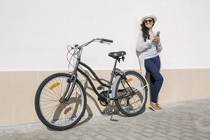 Smiley female with device and bicycle