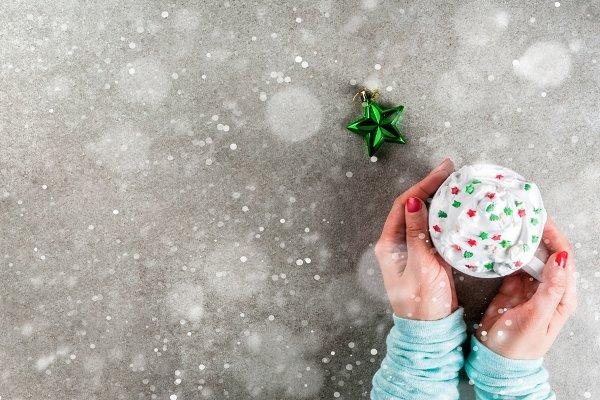 Girl drinks Christmas hot chocolate