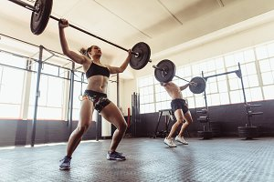 Man and woman doing weightlifting
