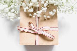 Christmas present with white flowers