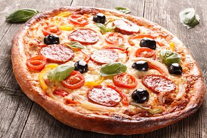 Pizza on wood background