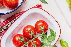 Tomatoes in enamelled bowls