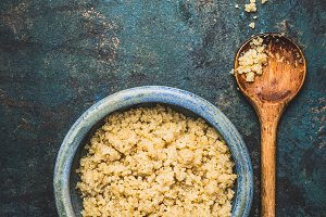Cooked quinoa in bowl with spoon