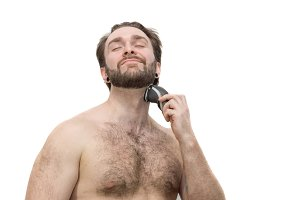 A man shaves himself against