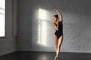 Asian dancer female engaged in modern ballet in the beautiful dancing hall