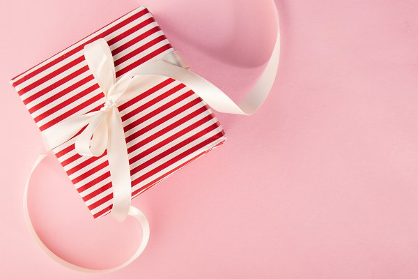 Closeup of gift on pink background
