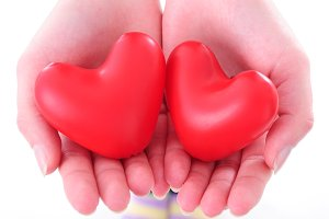 two hearts in female hands