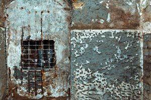 Concrete wall with window and cage,  abstract texture. prison imprisonment punishment concept