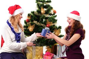 Two Christmas santa girl with gift