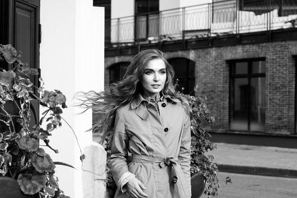 Girl standing on the street corner…