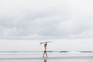 Girl with surfboard at beach