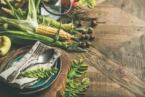 Fall table setting with seasonal vegetables