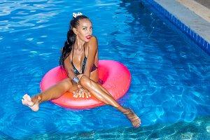 Beautiful woman have fun at pool.