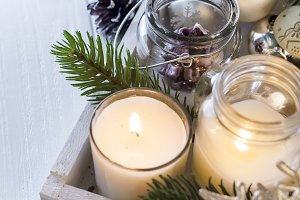 Burning candle and Christmas decoration