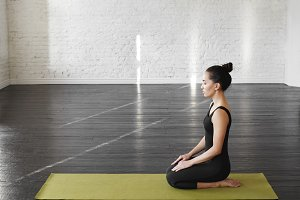 Attractive asian young woman doing meditation