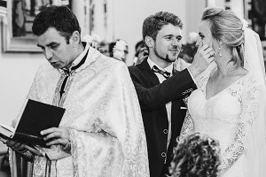 Lovely groom takes tears from bride