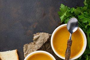 Bowls of hot vegetarian red lentil soup