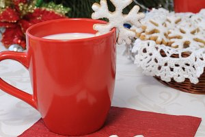 cup of milk with sugar cookies