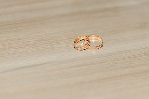 Wedding rings lie on the floor