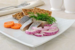 Slices of salted herring