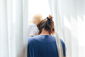 woman with her child looking out the window