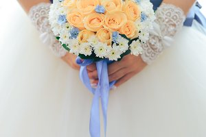 the bride is holding a bouquet