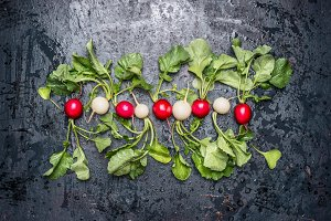 White and red radishes with leaves