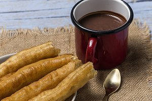 Churros with chocolate sauce.