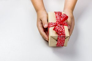 baby packs a handmade gift. Christma