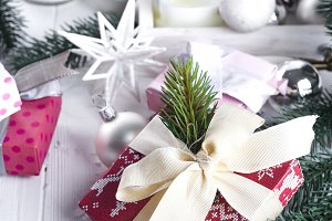Christmas fir tree, decor, gift box and mittens