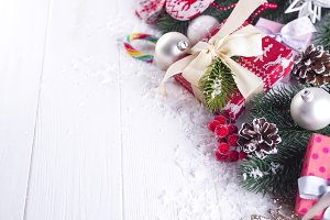 Christmas background with gift boxs, christmas tree, mittens and decorations