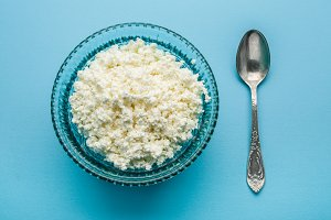 Cottage cheese in the glass bowl