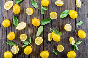 Ripe lemons on the wooden table.
