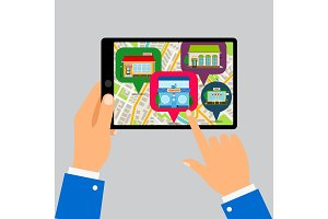 Hands holding tablet with restaurants map
