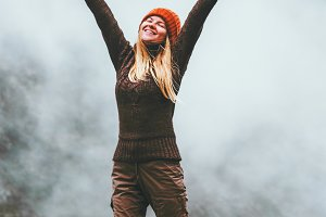 Happy woman in foggy mountains